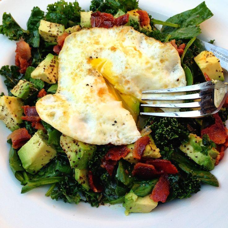 kale & spinach salad with avocado, a warm bacon vinaigrette, & fried egg