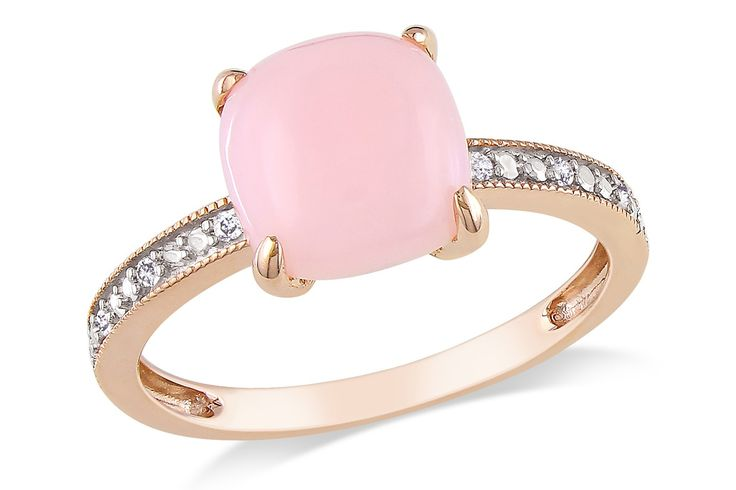 This gorgeous ring features a centered pink opal stone with dazzling diamonds on each side. Set in 10 karat pink gold, this ring will get you noticed wherever you go!