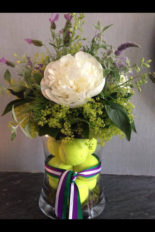 Tennis themed flower arrangement. Lovely as a party centre piece.