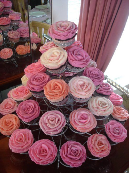 I love the idea of cupcakes for the guests so we aren't trying to cut a ton of sheet cakes. Nice, sweet, and clean.