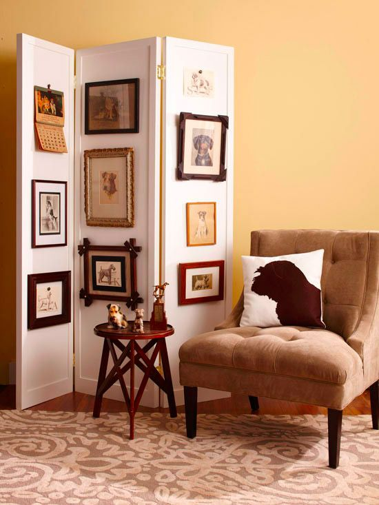 Display vintage finds in a unique way by making a rotating gallery. By hanging vintage pictures, such as these antique dog pictures, along a folding screen, you can change the display without adding holes to the walls. A folding screen also is a smart way to divide a room or conceal storage.