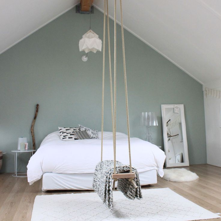 Nice attic bedroom with a rope swing neutral colors wooden floor