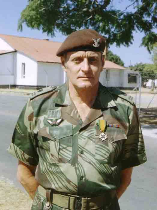 The insignia on his beret shows he's a Selous Scout. But his squared-away appearance & shoulder-boards suggests he's an officer, many who served in a rear-guard, administrative capacity. Lt./Capt. Simon Benford-Howe likely looked like this. BoetSwart.jpg (523×700)