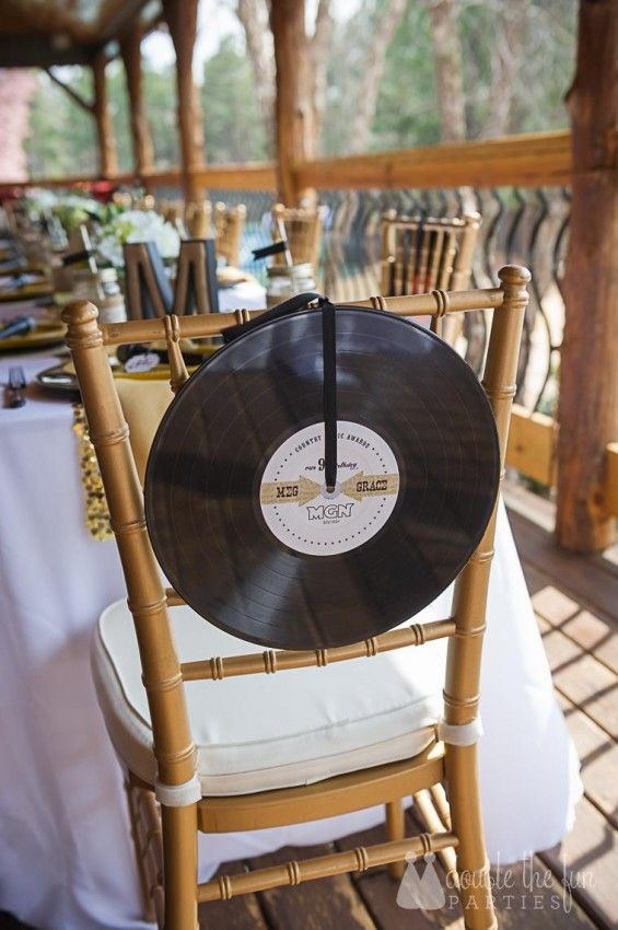 Vinyl records as chair backers - love this!   Country Music Awards Party by Double the Fun Parties
