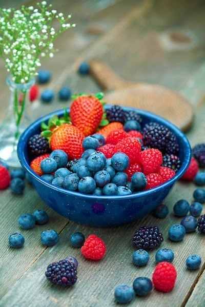 Like: the blue bowl with the different colors of berries.  And the weathered wood is a perfectly simple background.