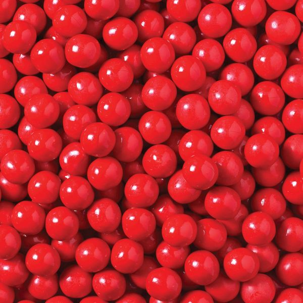 A bulk box of 12 bags of Allens Jaffas. Iconic round, orange flavoured chocolate drops that are coated in a delicious crispy candy shell.