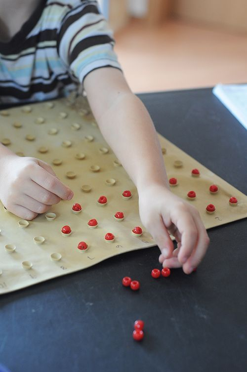 Creative counting & fine motor activity with an inverted bath mat!  (the kind with lots of tiny suction cups)