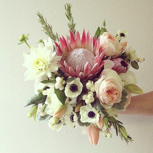 King protea bouquet, white anemones, garden roses, dahlias.