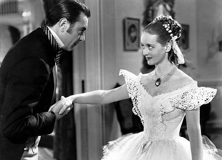 """Jezebel"" George Brent and Bette Davis 1938 Warner.  I loved this beautiful white lace gown from The Letter.  What a devious Southern belle she played in this movie!  Henry Fonda was also in this movie with Bette Davis and George Brent."
