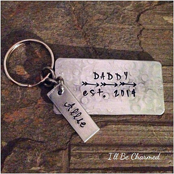 Daddy, Dad, Papa Grandpa Mom est. date with 3 Arrow and a Tag for Name or A Word Key Chain Hand Stamped Fathers Day Gift on a Aluminum Texture Rectangle Leave in Notes to Seller  1. •••>Name you want on top line- Dad, Daddy, PaPa, Name...up to 12 letters 2. •••>est. Date you want stamped 3. •••>Custom Personalized Bame for tag up to10 letters    Key chain measures approximately 1x 2 Hand Crafted Metal Key Chain ~~> This beautiful Handmade necklace is Hand Stamped It will come in a...