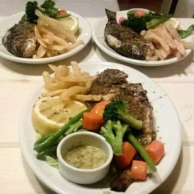 Fresh dorados served with steamed vegetables and a ladolemono sauce! #nissilefkada #food #greece #lefkada