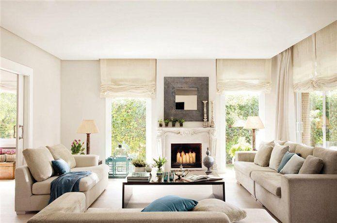 Armonía en grises y azules  Sofás, deB&B TAPIZADOS. Mesas auxiliares y lámparas, deHANBEL.  El mueble