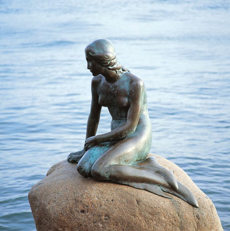 The original Little Mermaid statue us located in Copenhagen. Hans Christian Andersen is the author of the Little Mermaid, not Walt Disney.