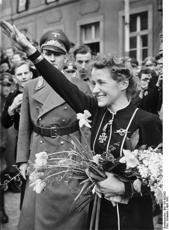 German Luftwaffe Flugkapitän Hanna Reitsch visiting her home town of Hirschberg, Germany, Mar-Apr 1941; note Reitsch's Iron Cross medal and the presence of local Gauleiter Hanke  Photographer   Schwahn  Source   German Federal Archive