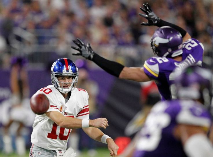 Monday Night Football: Giants vs. Vikings:   October 3, 2016  -  24 - 10, Vikings  -    New York Giants quarterback Eli Manning, left, throws a pass around Minnesota Vikings free safety Harrison Smith during the first half of an NFL game Monday, Oct. 3, 2016, in Minneapolis.