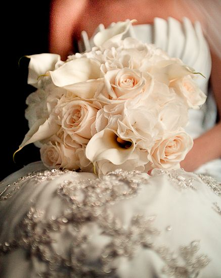 """Peach roses and calla lilies create a perfectly """"blushed"""" bouquet for the bride."""