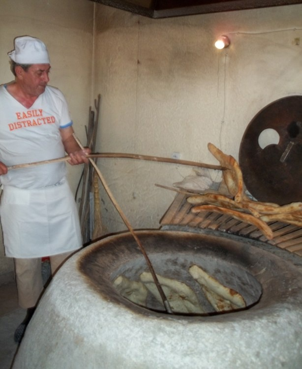 Georgian Bread Making - Removing Bread from the Tone