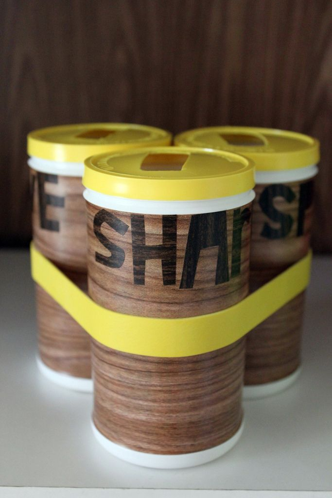 This Save/Spend/Share bank made from plastic frozen juice cans & woodgrain contact paper- love it!!