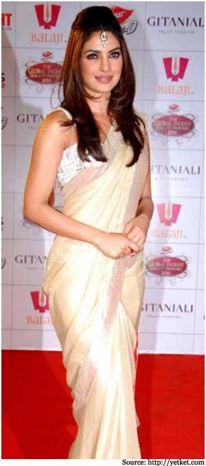 priyanka in an elegant cream saree