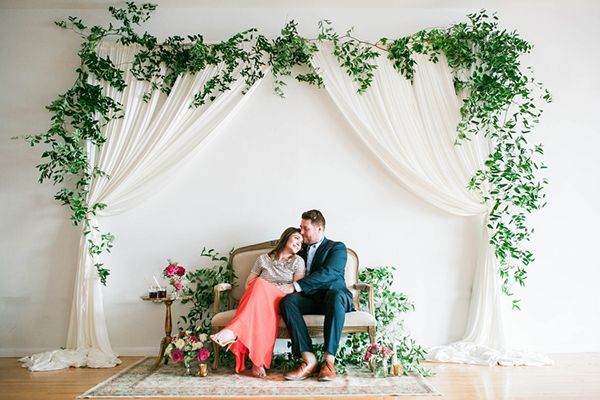 Curtains framed by a garland of fresh greenery   Photo by Morgan Lee Photography