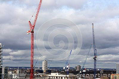Lots of cranes in the district of Poplar in the east-end of London where many new apartments are being built.