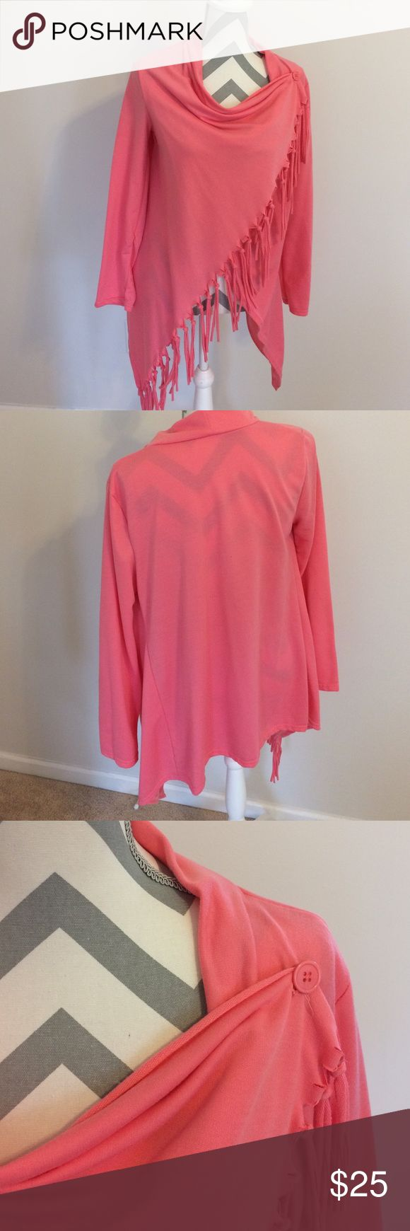 Pink Fringe Sweater Ok ladies...how cute is this!? Wear with jeans or leggings. Long length is perfect to cover the booty. Not sure what the material is but not a lot of stretch. Tag says XL but guys more like a large or medium. Only worn once so you know it's in great shape! Sweaters