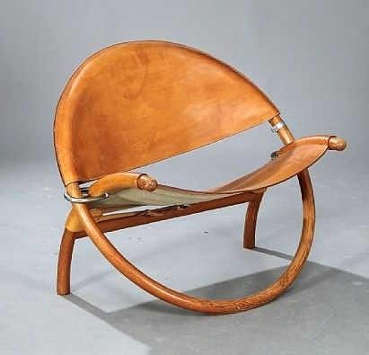 """""""Circle-chair"""" with folding frame of pine wood, metal fittings. Seat and back with thick patinated natural leather. Made 1976 by cabinetmakers Christensen & Larsen."""