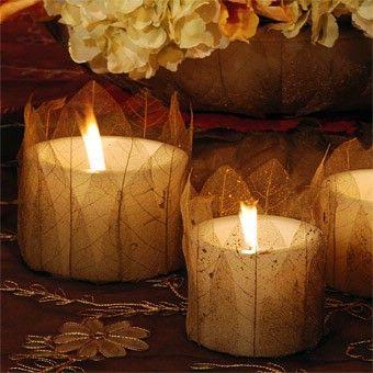 Skeleton leaves around votives... like being in Midsummer Night's Dream.-pretty, soft glow