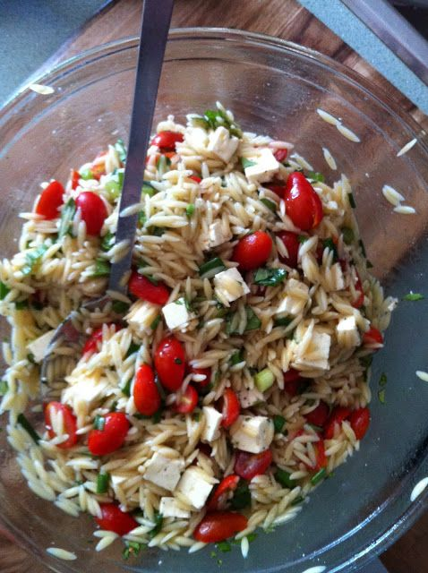 Caprese Orzo Salad. ------------------------------  1/4 cup red wine vinegar,  1 teaspoon honey,  1/2 cup olive oil,  1 pound orzo,  1 pint small cherry tomatoes, halved,  1 cup chopped fresh basil,  1 7-ounce container feta cheese, cut in to 1/4-inch cubes,  salt & pepper to taste,  (my note: add 1 garlic clove, omit onion),