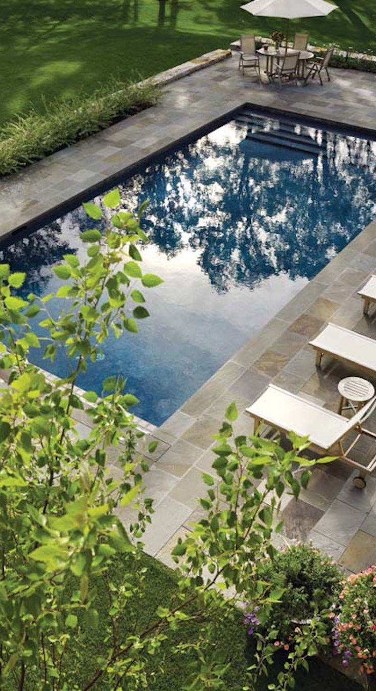 My ideal pool landscape but I want the pool in the next pin. It even has a circular table in the corner.