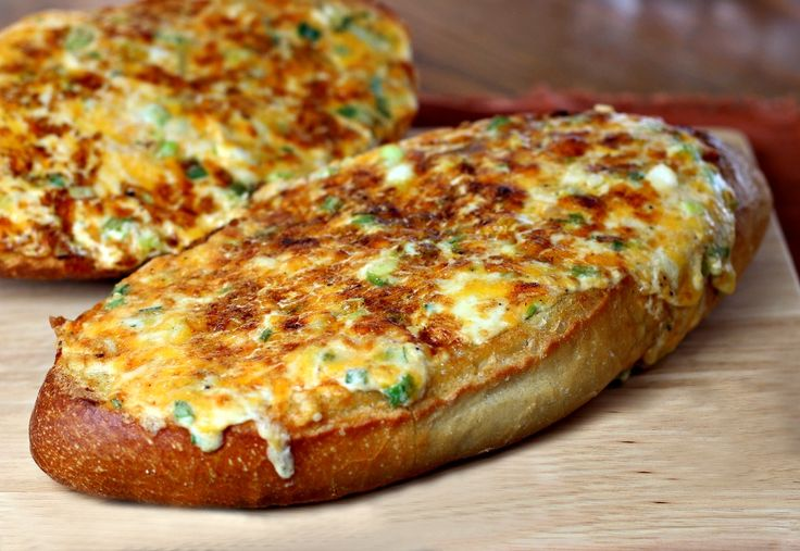 This cheesy herbed bread, bread topped with a cheese, mayo and herb mix, is sure to steal the spotlight from your main dish when you serve it for dinner.
