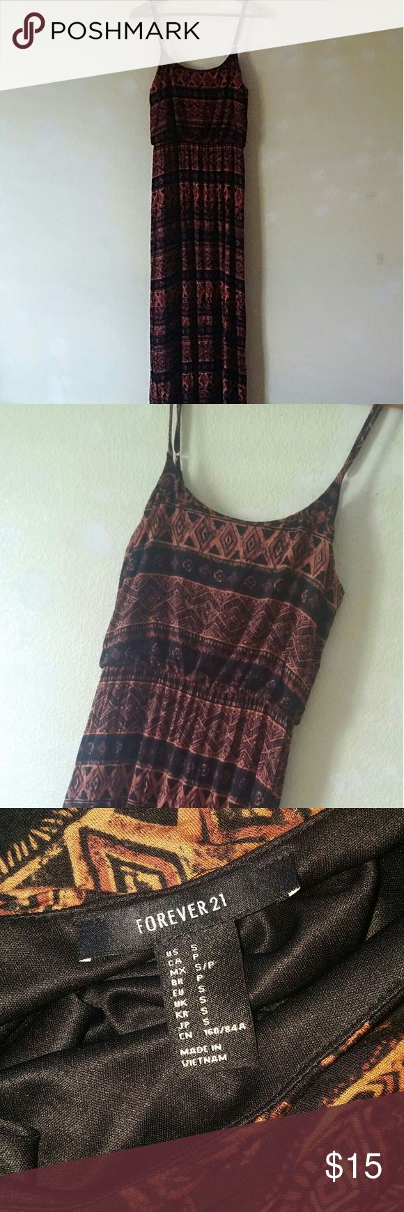 NWOT Forever 21 boho tribal aztec maxi dress Small Price is FIRM!   Forever 21 tribal printed maxi dress!  Never worn. Like new.  Underarm-underarm: 17 in.  Waist: 12.5 in., stretches up to 18 in. Length: 55  ~Free small gift included~ Forever 21 Dresses Maxi
