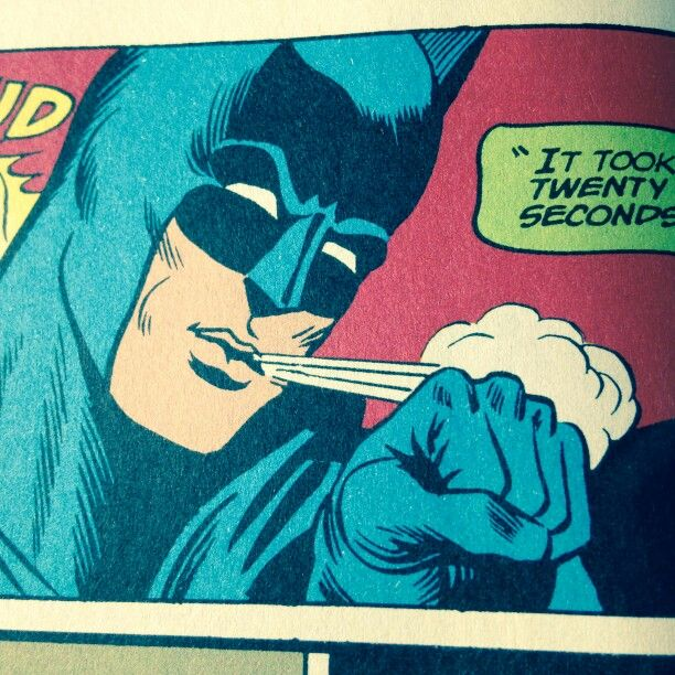 batman blowing off his knuckles