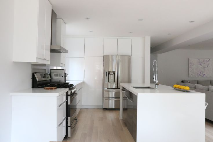"""Justyna and her husband loved the new, open-concept home they bought, but the kitchen wasn't exactly a selling point. They never even used it. The day after they moved in they took the kitchen right out, along with the wall that held the refrigerator. """"The old kitchen stuck out like a sore thumb,"""" said Justyna. …"""