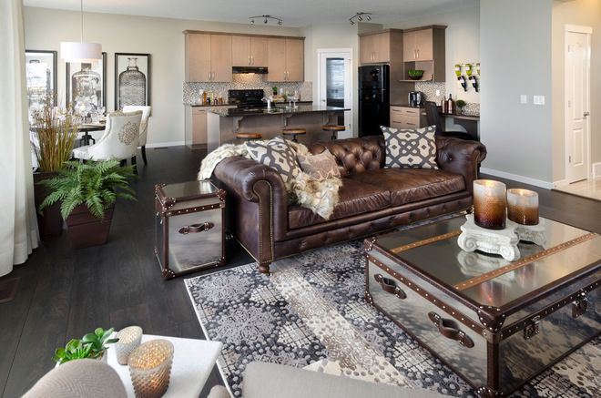 contemporary living room by Morrison Homes The black and gray colours go well with the brown leather couch.