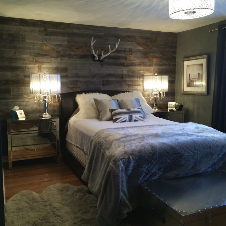 Lux cottage master bedroom retreat. Love the use of reclaimed wood on wall, it makes this space cozy and warm.