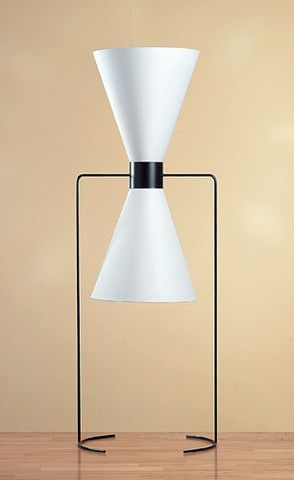 "This sculptural Isamu Noguchi floor lamp designed in 1940 stands 46"" tall."