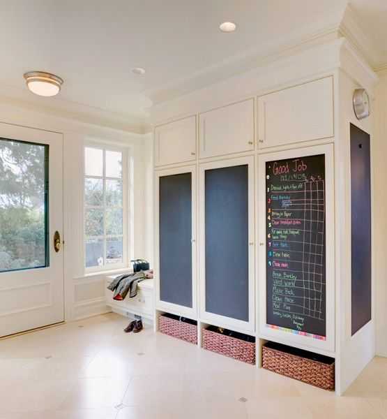 What would be a simple dividing wall between this Seattle's home entryway and kitchen was cleverly crafted into a functional family center. Designer Colleen Knowles and architect Margaret Menter crafted the cabinets into lockers with one for each member of the family, including the dog. Inside the cabinets, there are electrical outlets, so each person can also charge a device if needed.