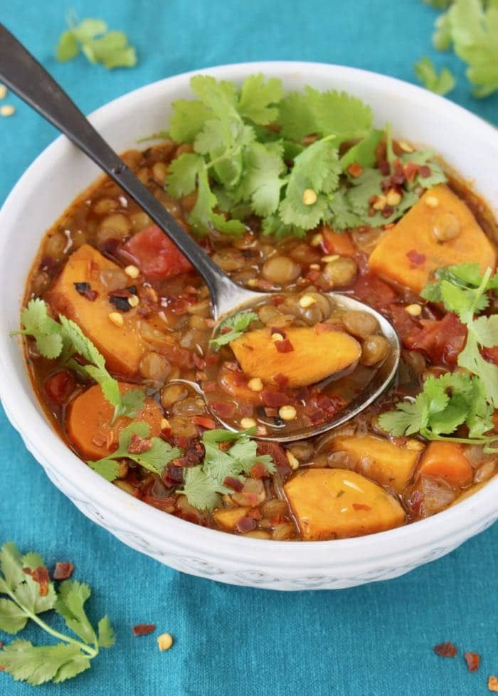 The best vegan sweet potato lentil soup recipe, bursting with Mexican flavors from fire roasted tomatoes, smoked paprika and cumin. Easy, Hearty, healthy and gluten-free.