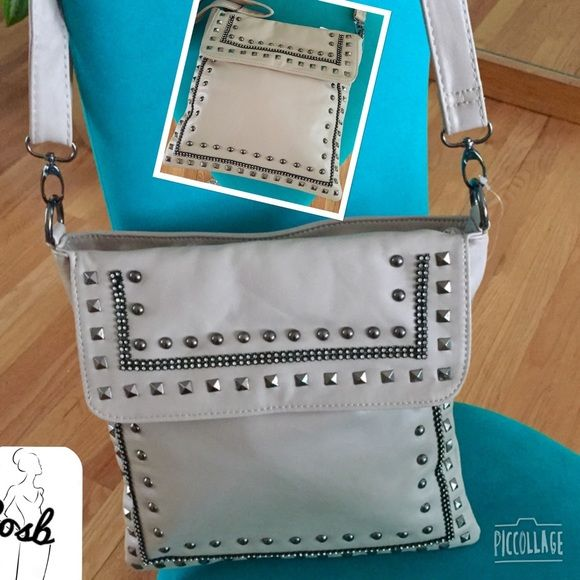Light Taupe Small Handbag w/Nail Heads Light Taupe Handbag with Square & Round Nail Heads. Bag is square shaped, has an adjustable shoulder strap for shoulder bag or cross body. Back has a zipper pouch. Measurements are 11.5 by 11.5 inches. Cosb Bags Shoulder Bags