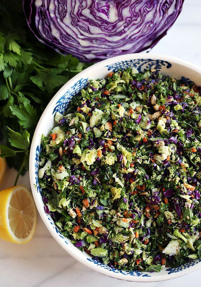 This delicious detox salad is loaded with healthy veggies like brussels sprouts, broccoli, kale and cabbage and makes a ton to last you all week!