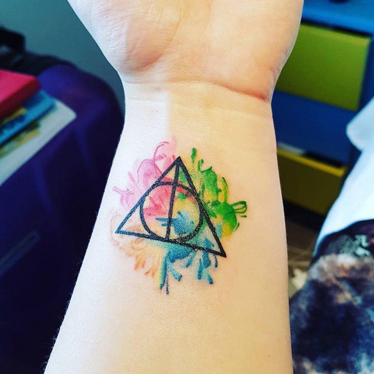 Flaunt your love for the classic Harry Potter symbol with all the colors of the rainbow with this ROYGBIV tat worn by Deborah Justine. Alchemy Tattoo Studios in Melbourne, Australia, created this fab tattoo, so we'd totes recommend them.
