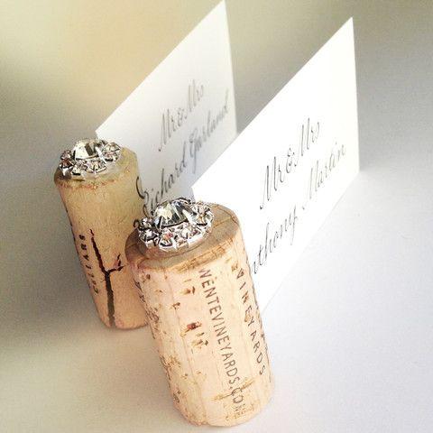 A Vintage wine cork capped with a sparkling, Grade A glass gem.  Unique wedding Place Card Holder idea!