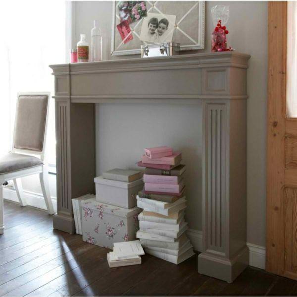 fausse cheminee avec cadre photos et livres                                                                                                                                                                                 Plus