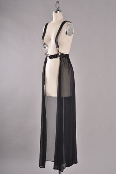filthymagic: This harness-style dress features belt and buckle silver metal detail and vegan leather-strap suspenders.