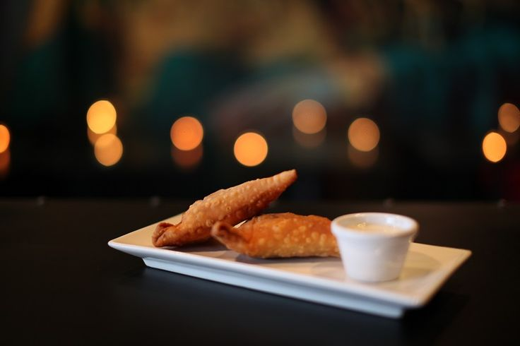 VEGETABLE SAMOSAS    Vegetarian from the A La Carte Menu    potato, veg and green chilli rolled into a pastry and shallow fried served with a cooling cucumber yogurt