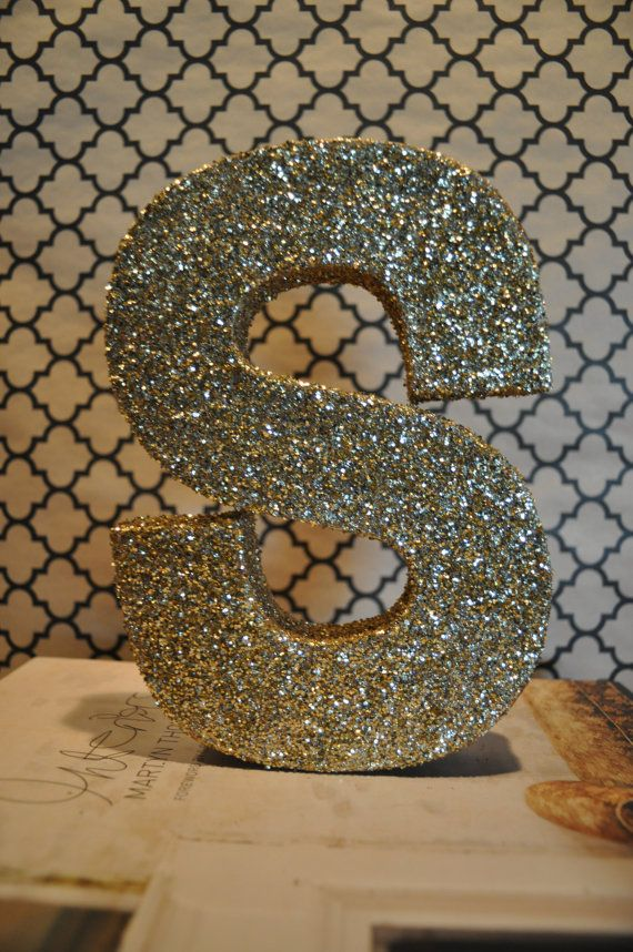 Glitter letter. Good idea for party tablescape. LG wood letters $5 at Walmart, glue, glitter!