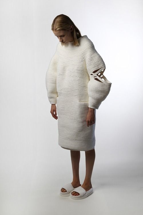 Mokuba 2014 The dress from the collection is an strong example of a well fitted yet oversized piece. The simple colour palette allows for the structure to 'speak' per say for itself. The tactile chunky nature of the rope adds a point of difference to the piece. credit: katherinemavridis.com