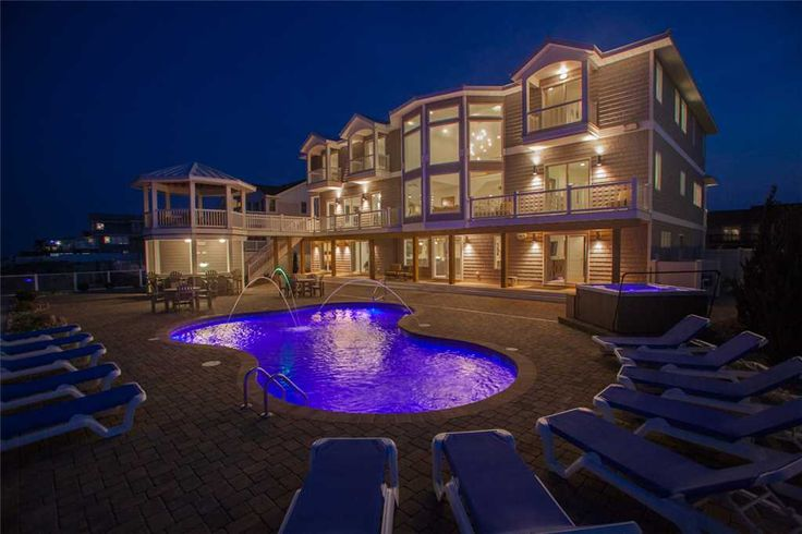 Royal Shell is a Sandbridge Oceanfront vacation rental that sleeps 30. Contact Sandbridge Realty for more information!