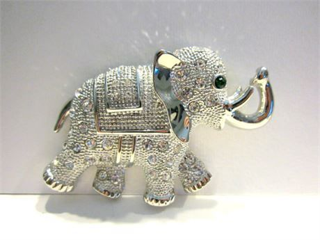 Vintage Rhinestone Elephant Brooch Vintage Large Silver Green Rhinestone Eye Elephant Gift for Her Elephant Jewelry Under 25  HUGE Rhinestone elephant, his ears are dimensional and actually are fluted out. Clean clear rhinestones and sparkling green eye set in silver tone metal. It is in excellent (appears never used) vintage condition from the 80s.  U.S. Shipping is 3.50 Thank you! 6E